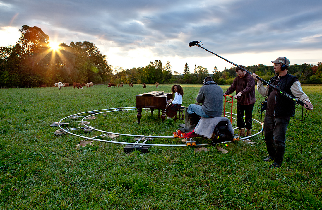 "nichola feldman-kiss, after, Africa \ ""So long, Farewell"" (sunset) / a yard of ashes (continuous cross dissolve) / ""Oh! How I hate to get up in the morning!"" (sunrise) (2012). Photo of set crew."