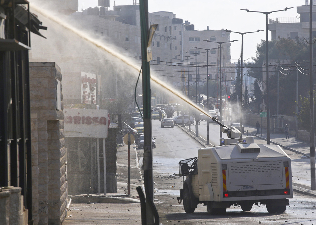 "Rehab Nazzal, A ""Skunk"" truck spraying sewage on Palestinian homes and workplaces in Bethlehem, 2015."